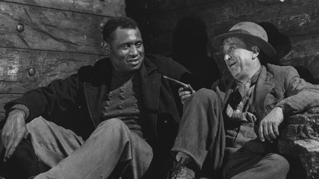 Paul Robeson (on L) stars in The Proud Valley