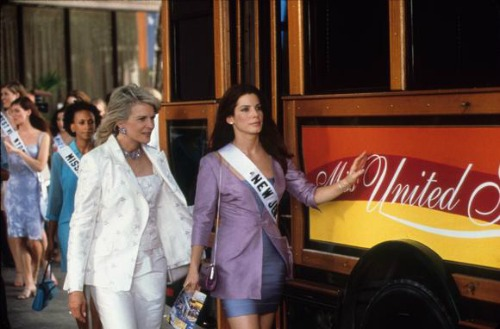 Candice Bergen and Sandra Bullock walk in front of a re-purposed Dillo in Miss Congeniality